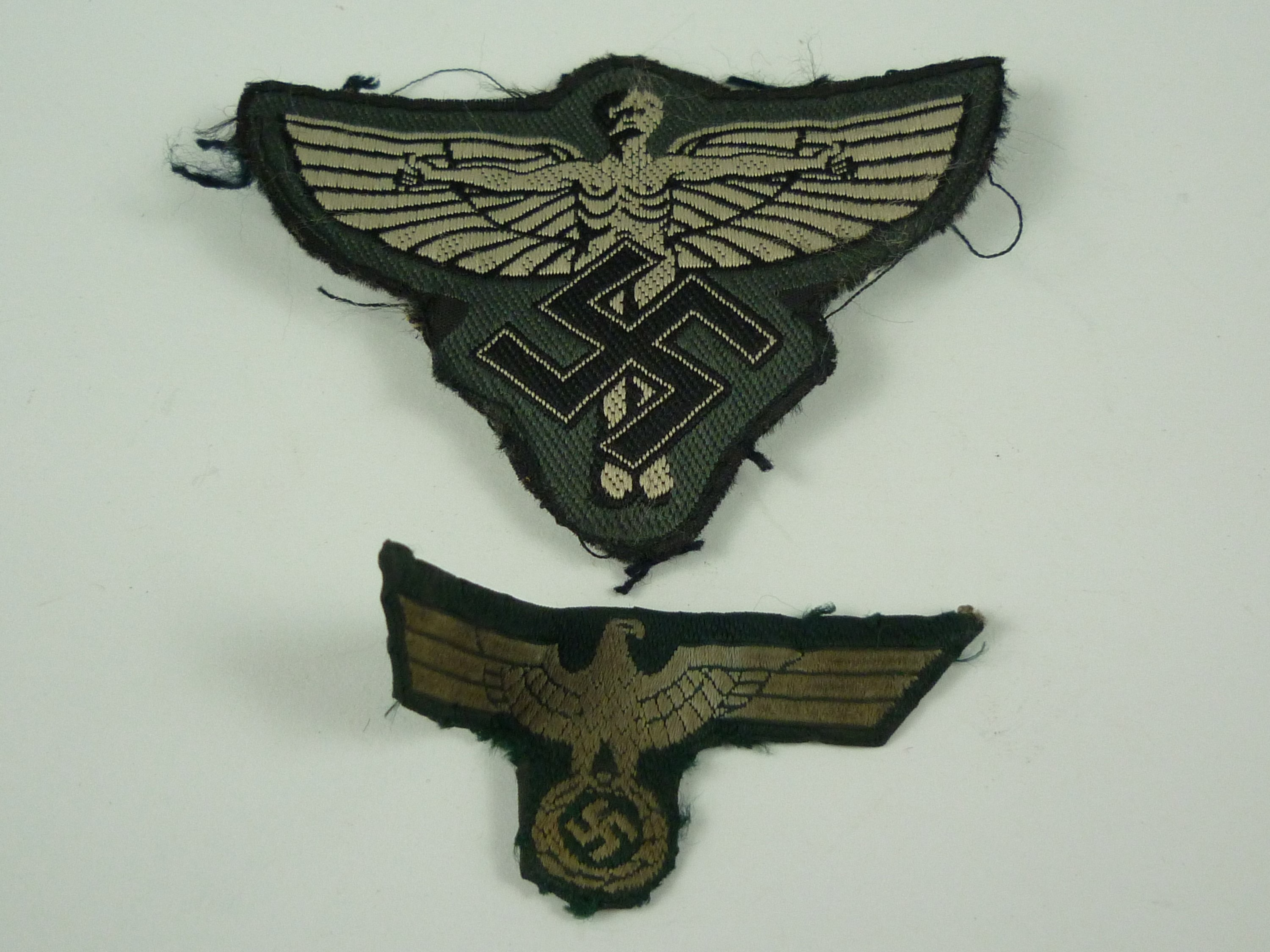 Lot 43 - A German Third Reich army BeVo cap badge and an NSFK national emblem