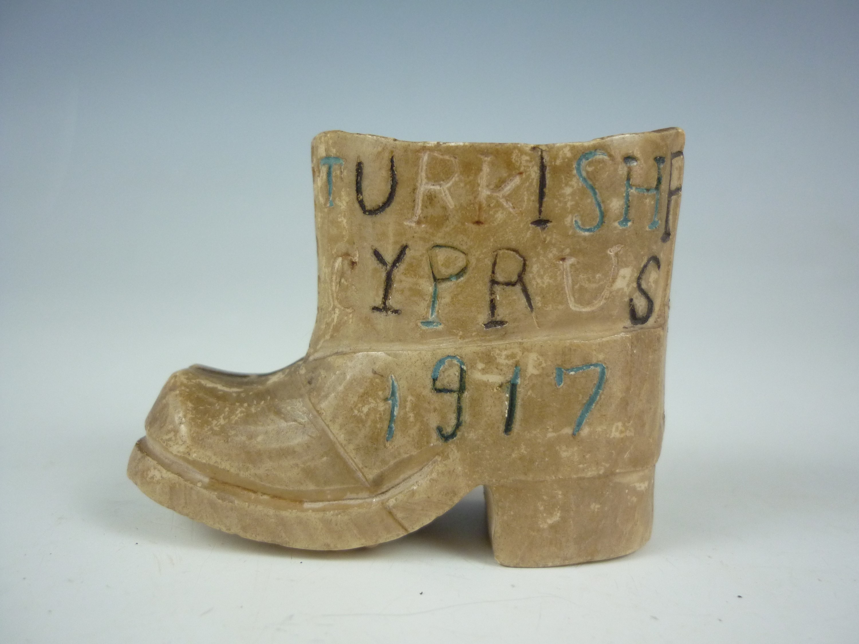 Lot 52 - A pair of Prisoner of War work carved stone jack boots bearing the inscription Turkish Prisoners,