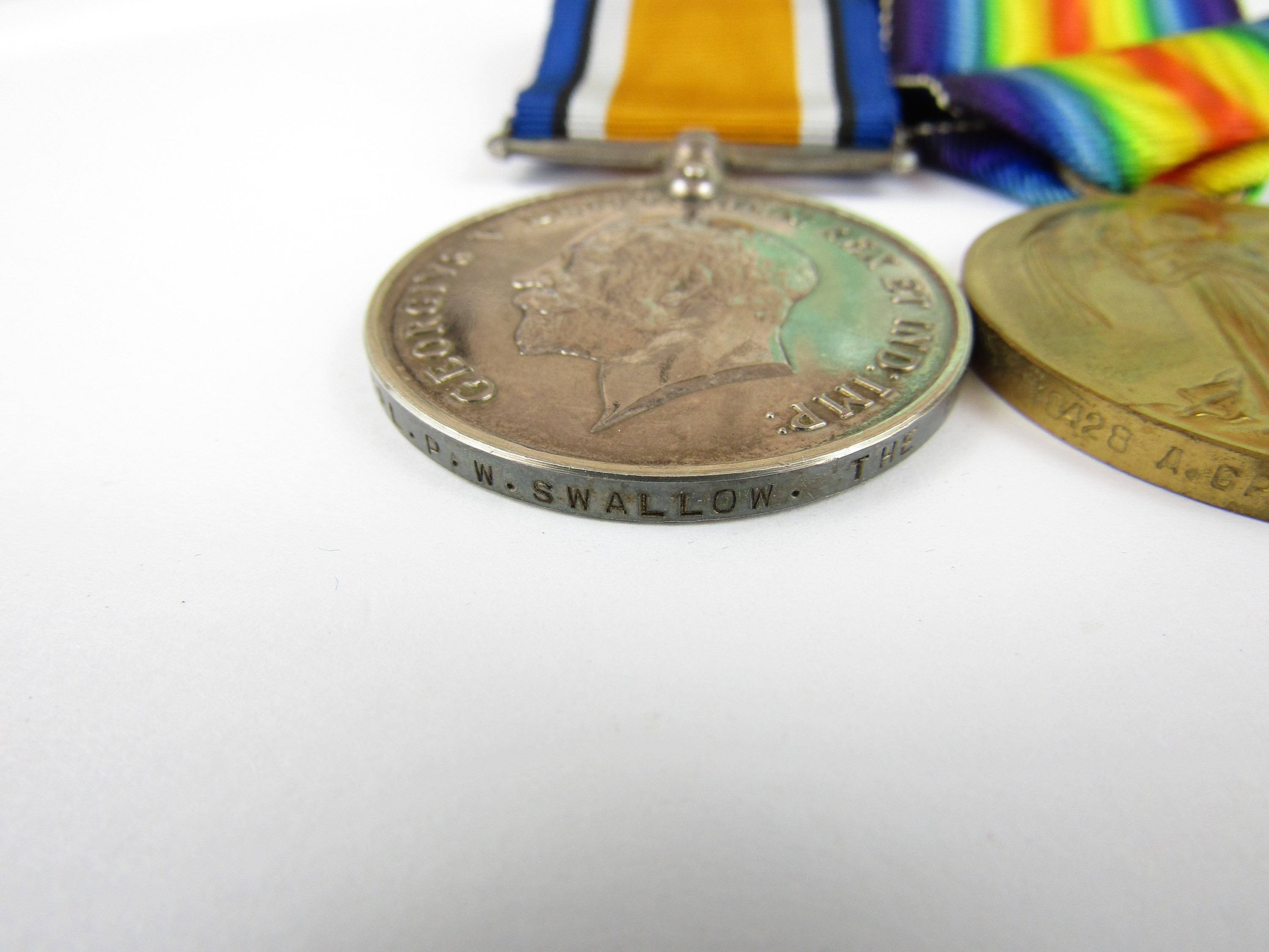 Lot 13 - A British War and Victory Medal pair to 18428 A Cpl P W Swallow, The Queen's Regiment