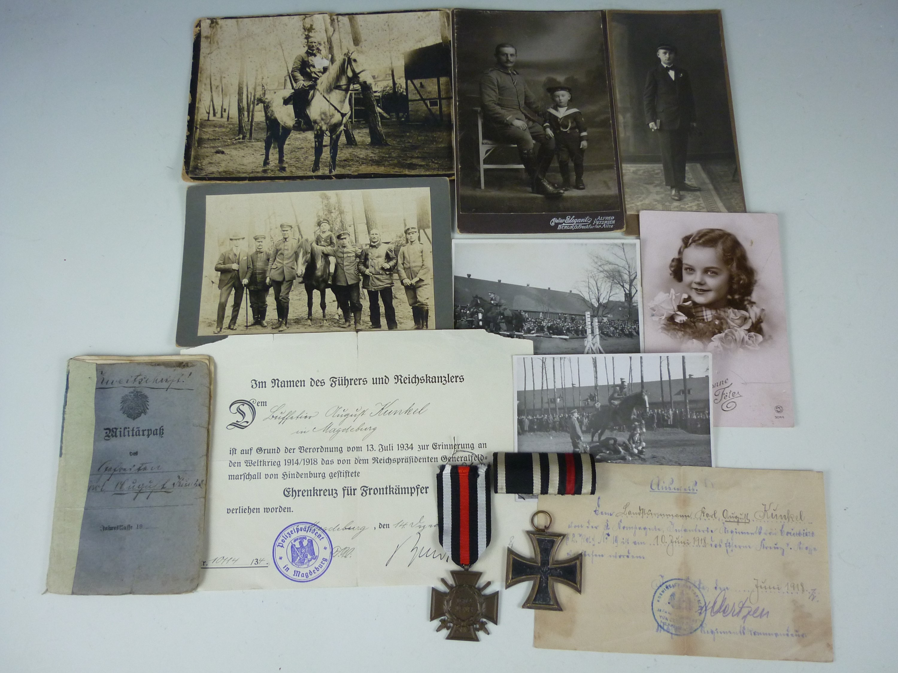 Lot 4 - An Imperial German medal and document group, comprising Iron Cross Second Class and Honour Cross,