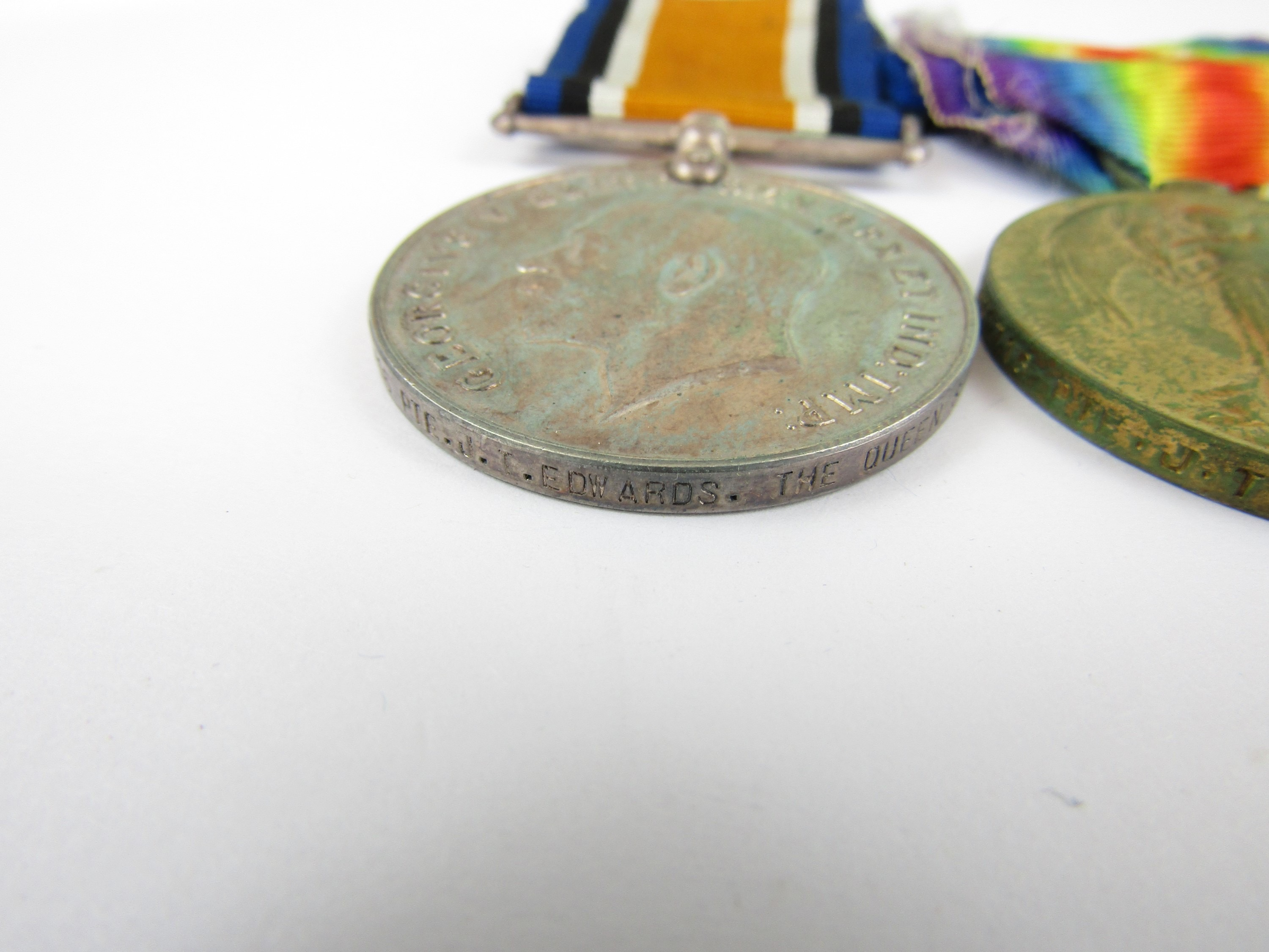 Lot 11 - A British War and Victory Medal pair to G-31716 Pte J T Edwards, The Queen's Regiment