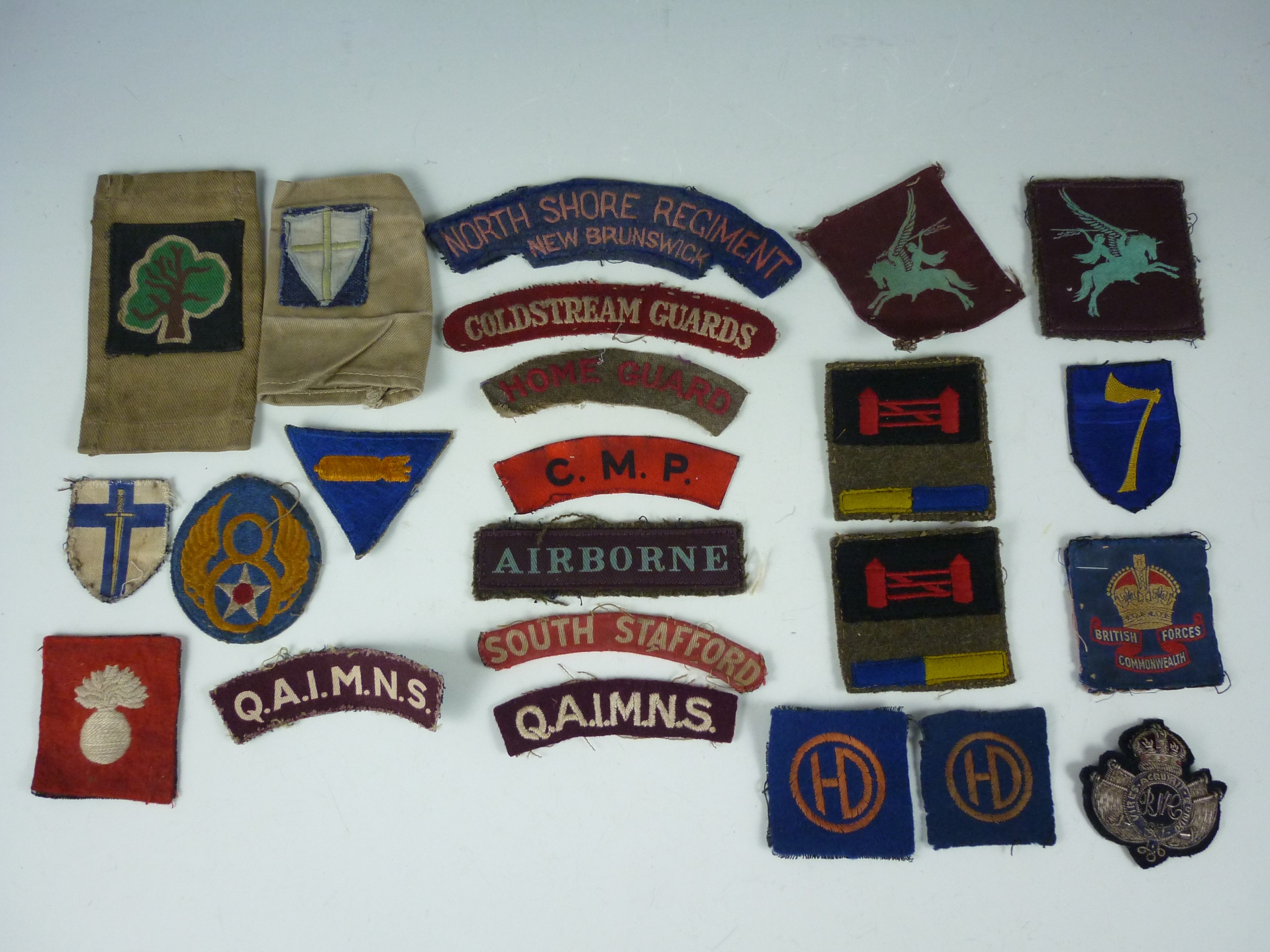 Lot 42 - A quantity of largely Second World War British military cloth insignia