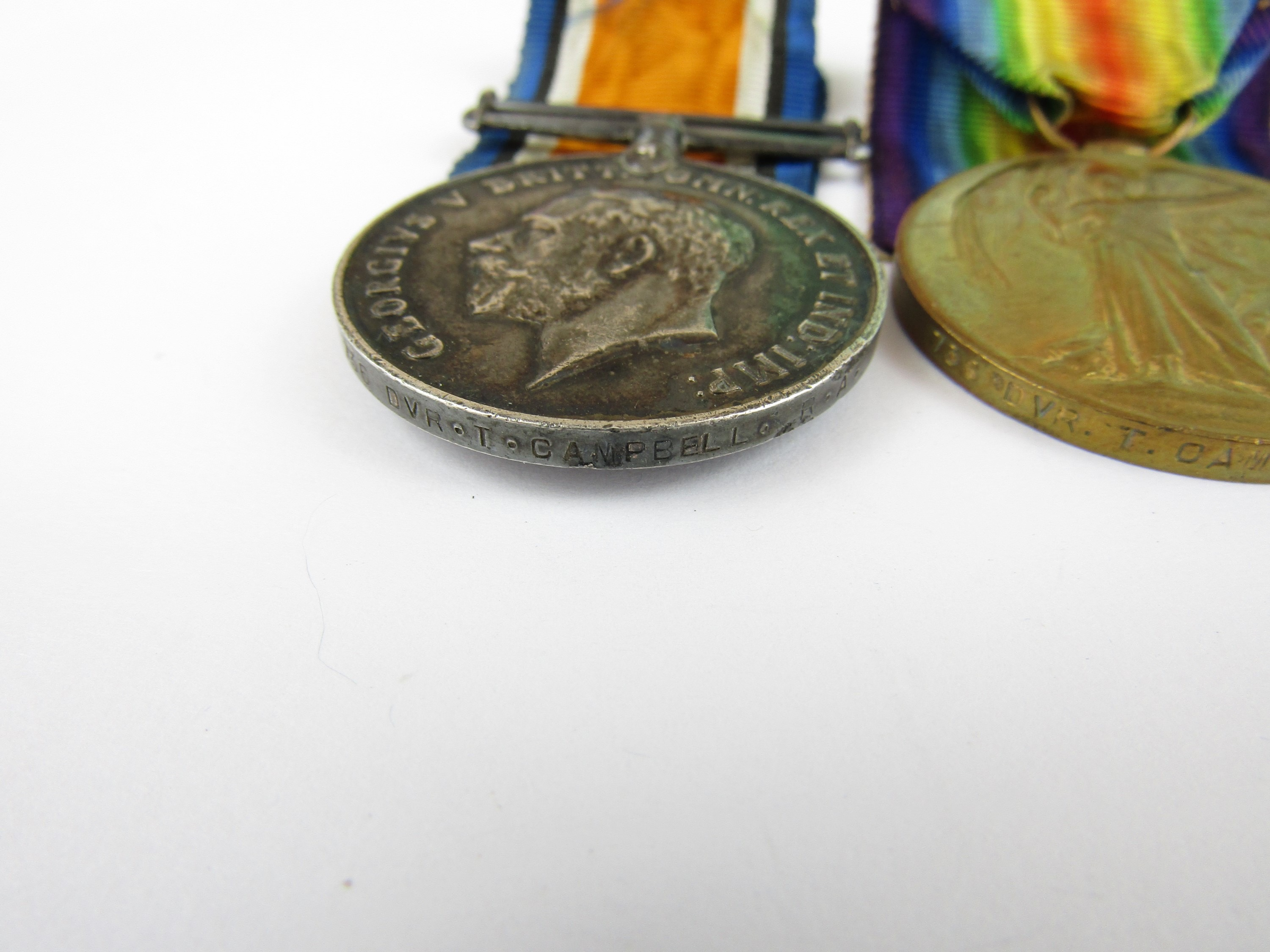 Lot 12 - A British War and Victory Medal pair to 736 Driver T Campbell, Royal Artillery, together with