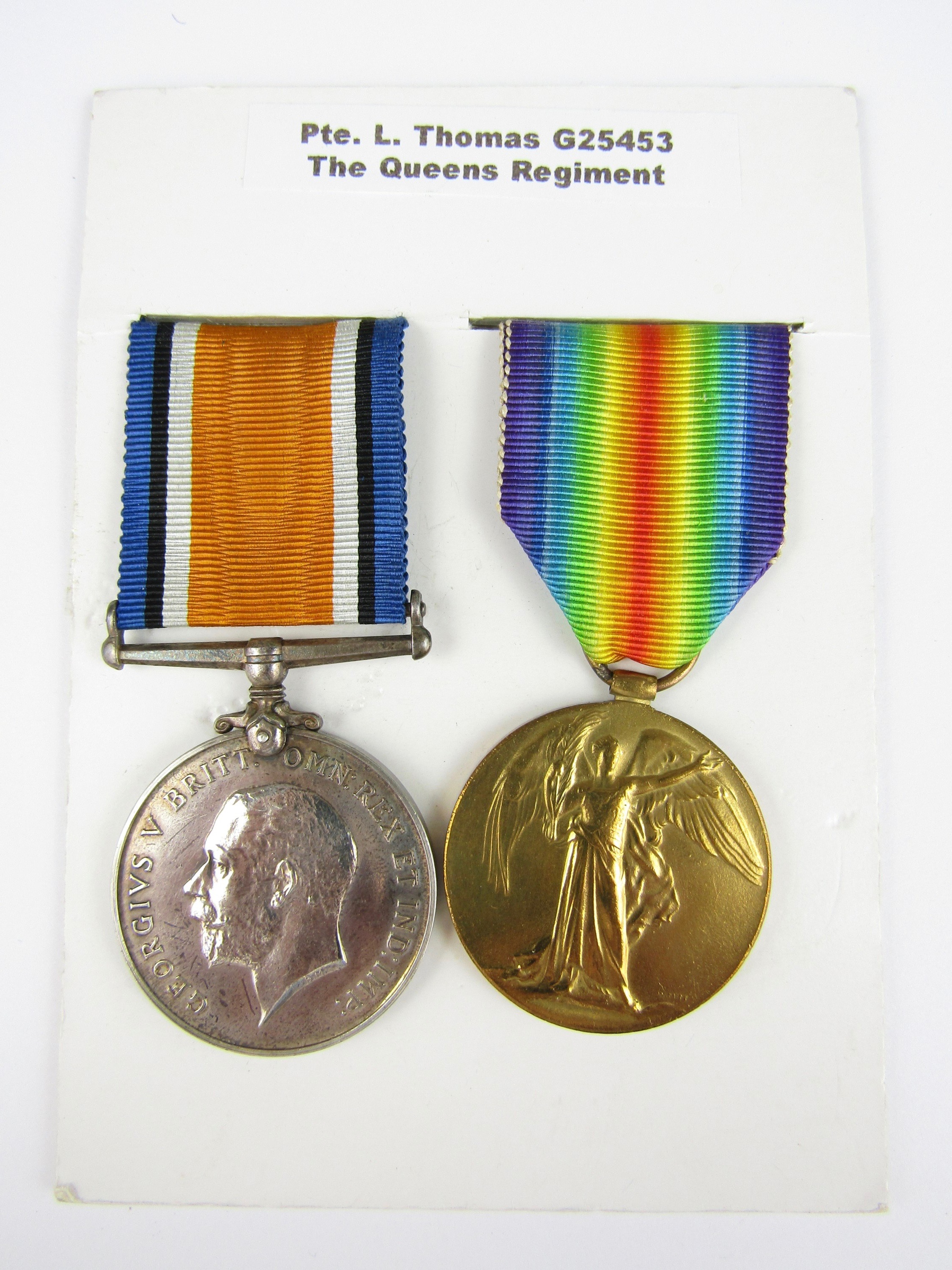 Lot 14 - A British War and Victory Medal pair to G25453 Pte L Thomas, The Queen's Regiment