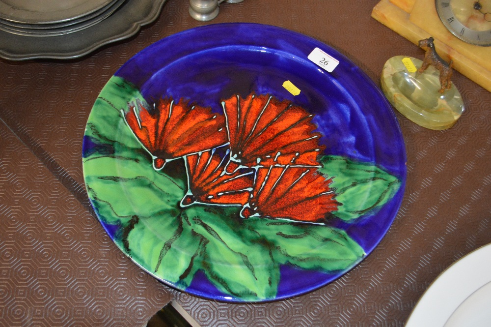Lot 26 - A Morris & James pottery glazed charger