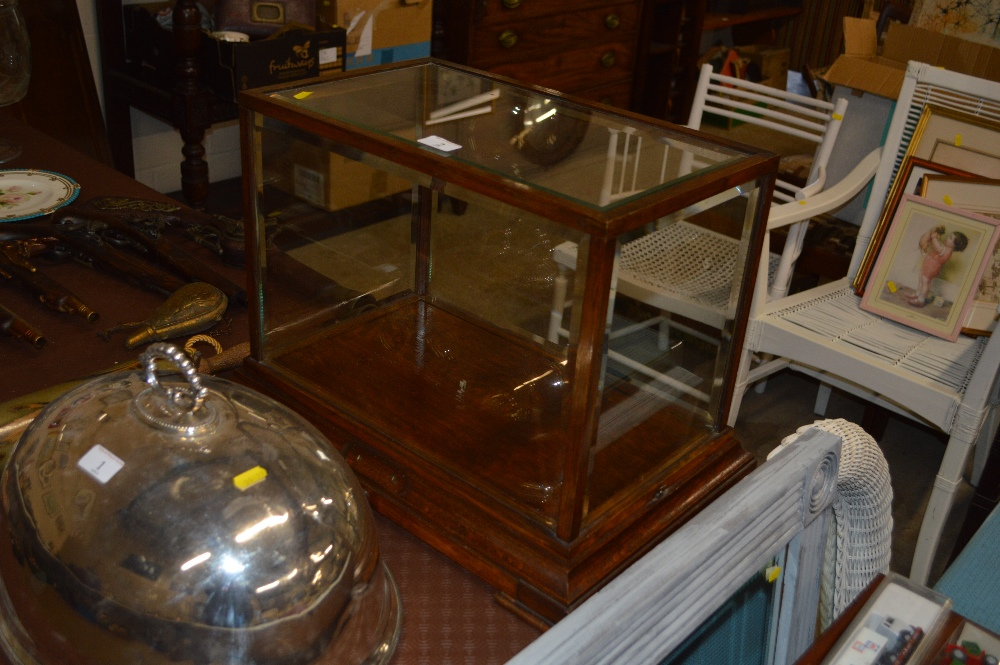 Lot 2 - An oak and bevelled glass table top display case