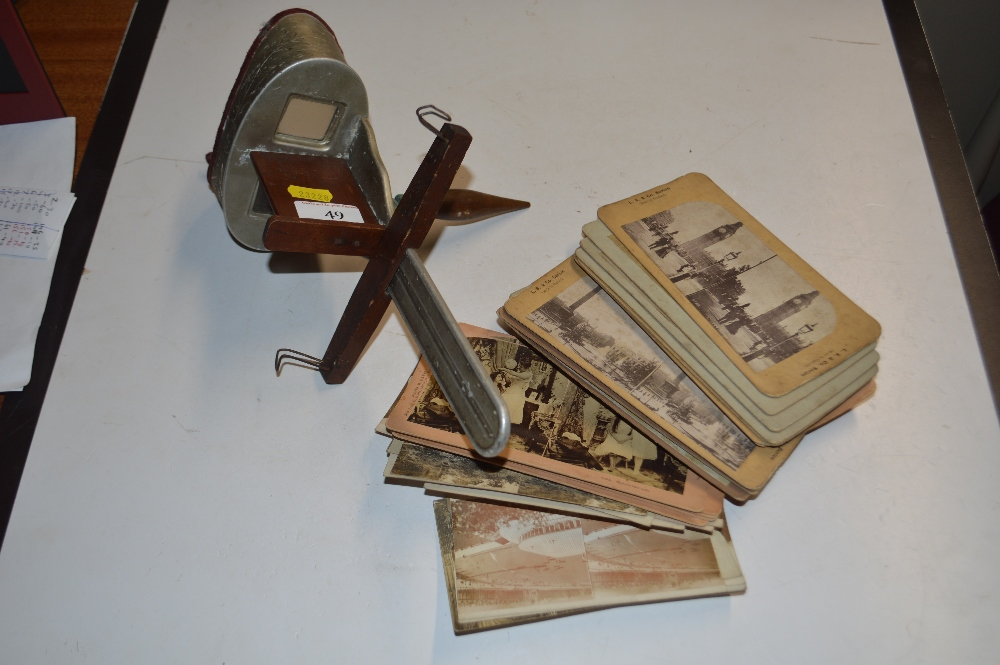 Lot 49 - A stereoscopic viewer and cards