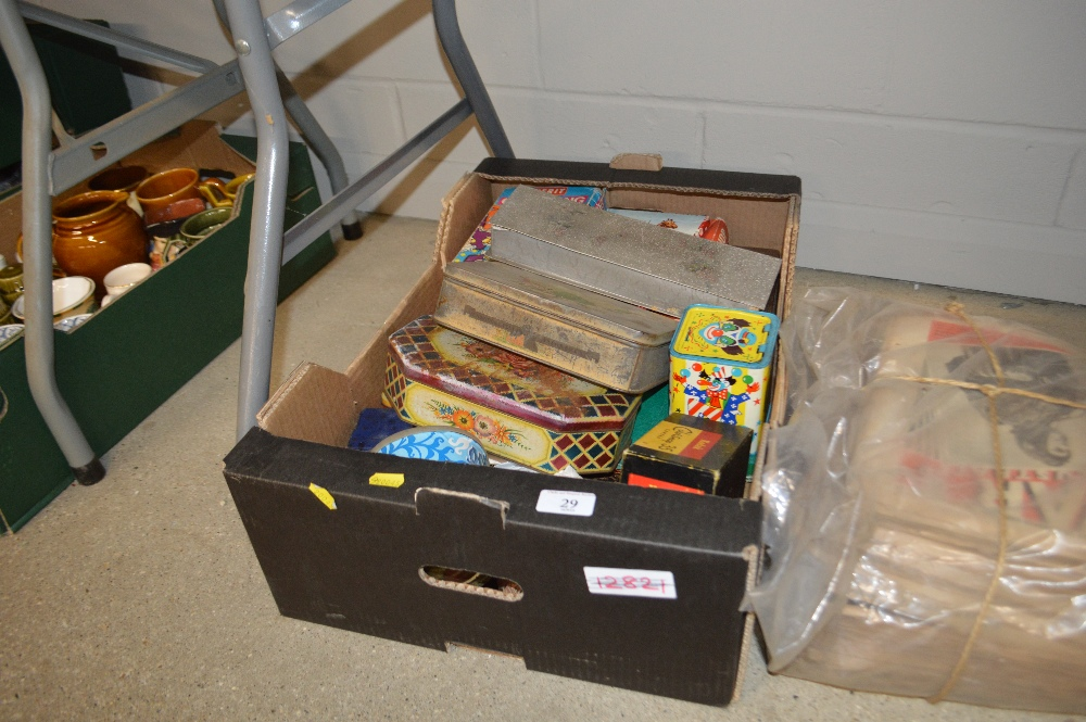 Lot 29 - A box of games and tins