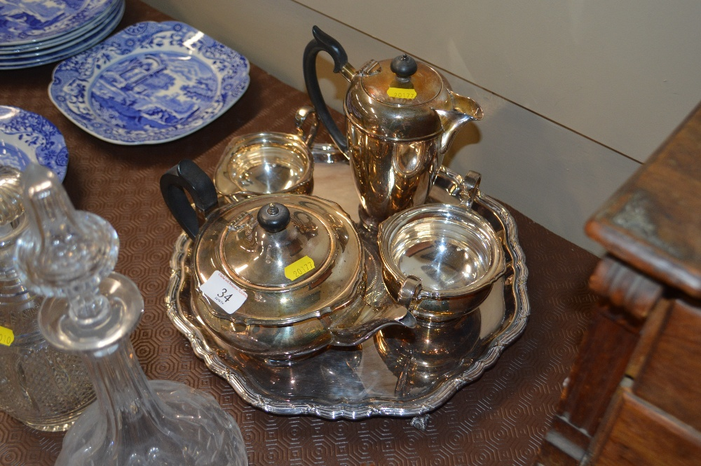 Lot 34 - A Mappin & Webb silver plated four piece teaset on