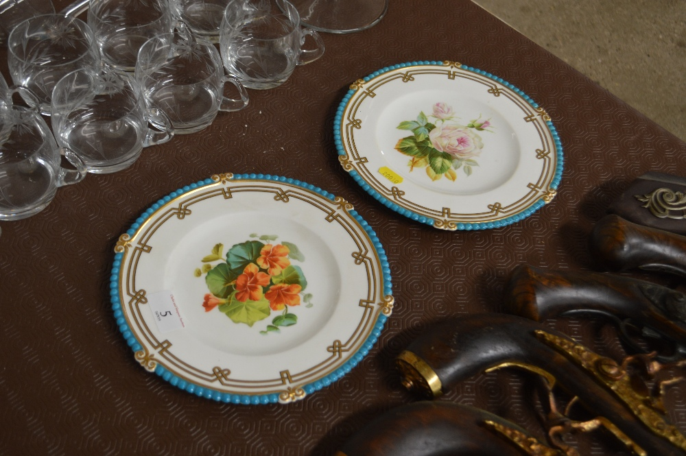 Lot 5 - A pair of Minton floral decorated cabinet plates