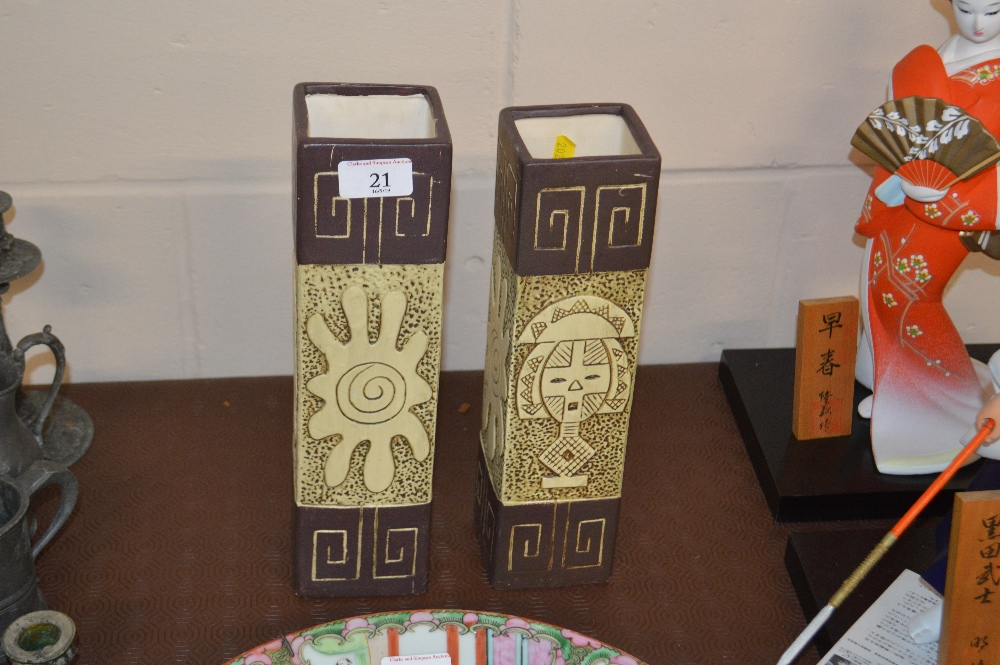 Lot 21 - A pair of pottery vases of square form