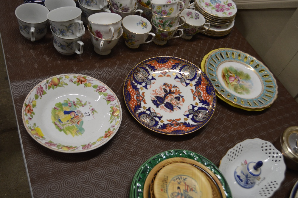 Lot 37 - Two figural decorated plates and two other old pla