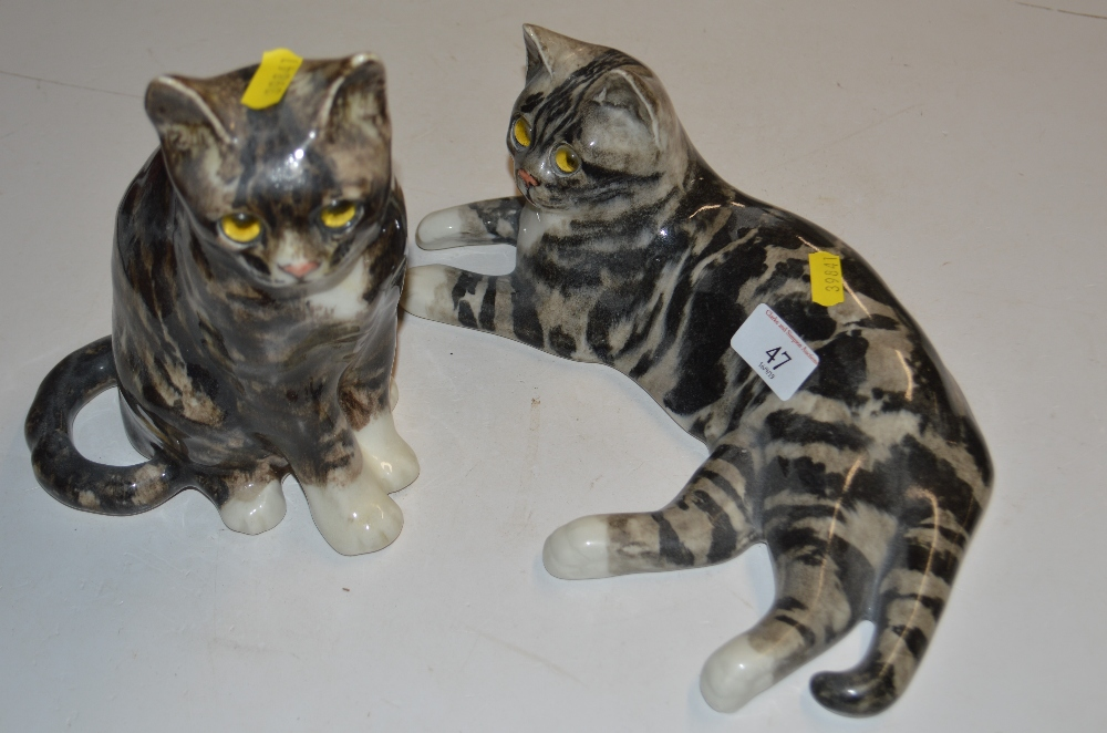 Lot 47 - Two pottery Winstanley style cats with glass eyes