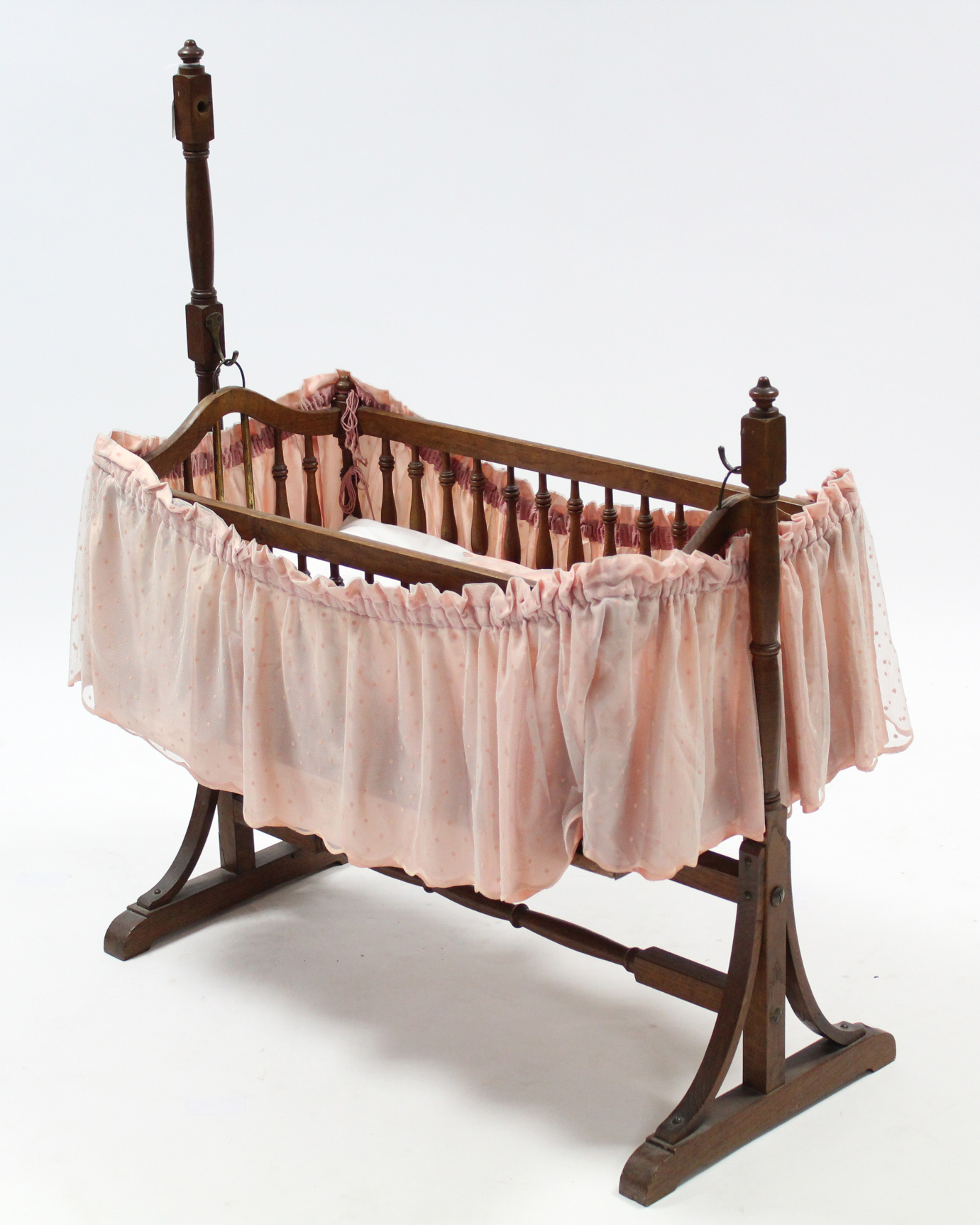 "Lot 170 - A late 19th/early 20th century oak rocking dolls crib, 33"" long, complete with bedding."