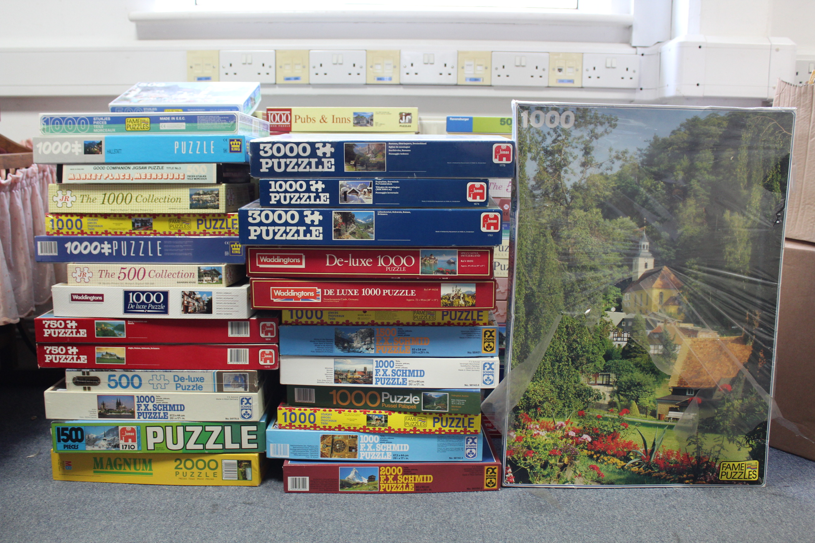 Lot 213 - Approximately eighty various jig-saw puzzles, all boxed, some as new.