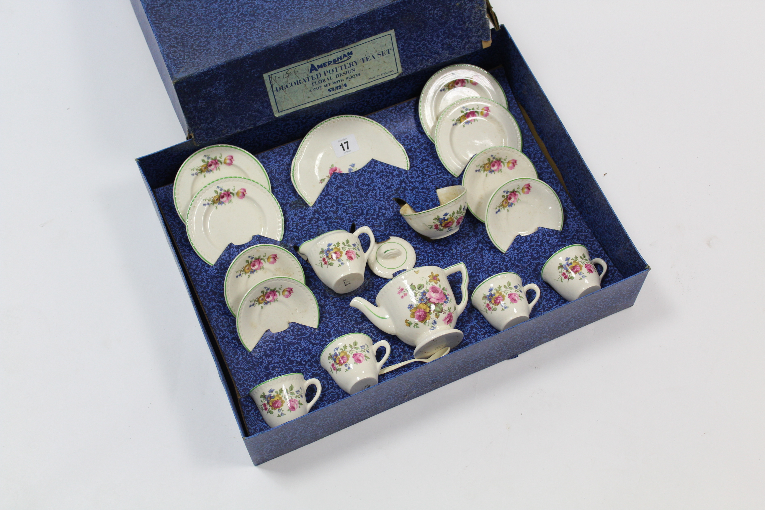 Lot 17 - An early-mid-20th century child's sixteen-piece floral tea service (settings for four), boxed.