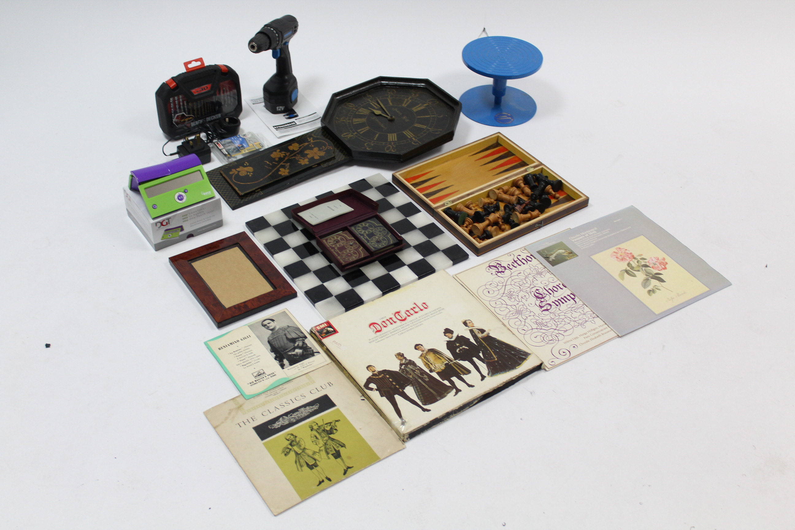 Lot 237 - A matched carved wooden chess set; a chess board; various records; two power tools; a miniature
