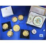 """Modern Estee Lauder Star Sign Compacts, together with """"December Angel"""" compact, Kigue compact and"""