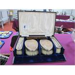 A Cased Set of Four Hallmarked Silver Backed Brushes, SB, Birmingham 1926, complete with matched