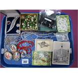 """An Openwork Set Bar Brooch, stamped """"9ct""""; Limoges ceramic panel brooches, bead necklaces,"""