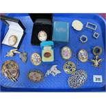 A Collection of Assorted Costume Brooches, including oval shell carved cameo, Limoges ceramic panel,
