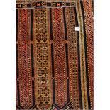 MID 20TH CENTURY RUG WITH GEOMETRIC PATTERN ON A DARK RED AND BLUE GROUND 99CM X 135CM APPROX