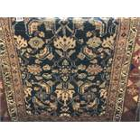 EARLY 20TH CENTURY CAUCASIAN RUG ON A BLUE AND RED GROUND 101CM X 180CM APPROX