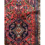 CAUCASIAN RUG ON A RED AND BLUE GROUND 105CM X 200CM APPROX