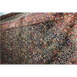 LATE 19TH/EARLY 20TH CENTURY CAUCASIAN CARPET ON A BLUE AND RED GROUND EXTENSIVELY DECORATED,