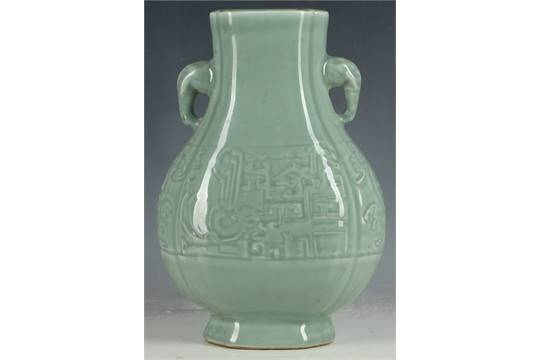 A Chinese Celadon Glazed Twin Handled Vase With Apocryphal Qianlong