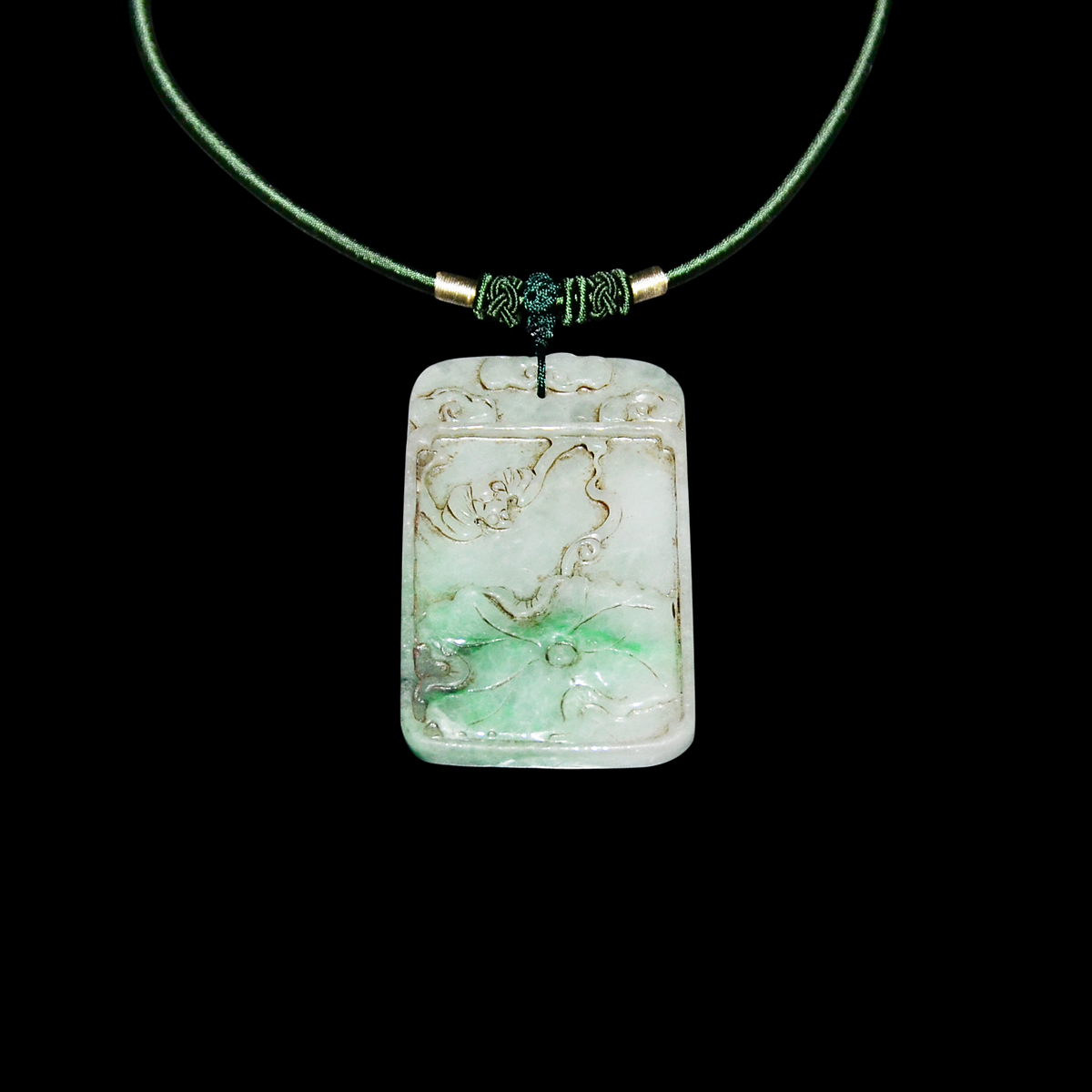 Lot 24 - 翠玉雙面雕荷葉如意蝠來珮 Jadeite Pendant Carved on Both Sides with Ruyi Lotus and Bat Motifs Signifying