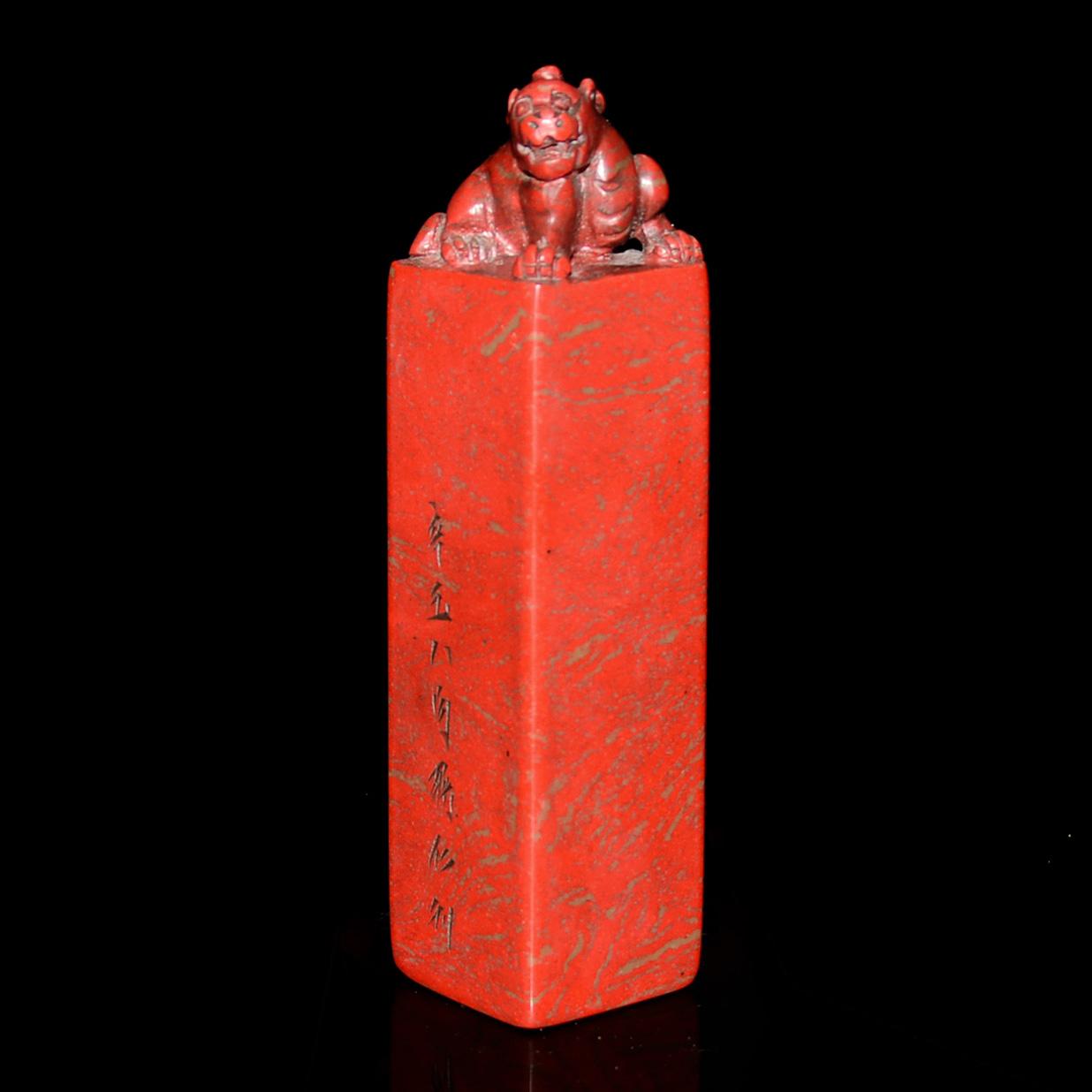 Lot 44 - 雞血石長辟邪鈕印章 印文(仁者無敵) 刻文(辛丑八月蔣仁刻) A Well Carved Tall Columnar Jixue Stone Seal with Bixie Knob