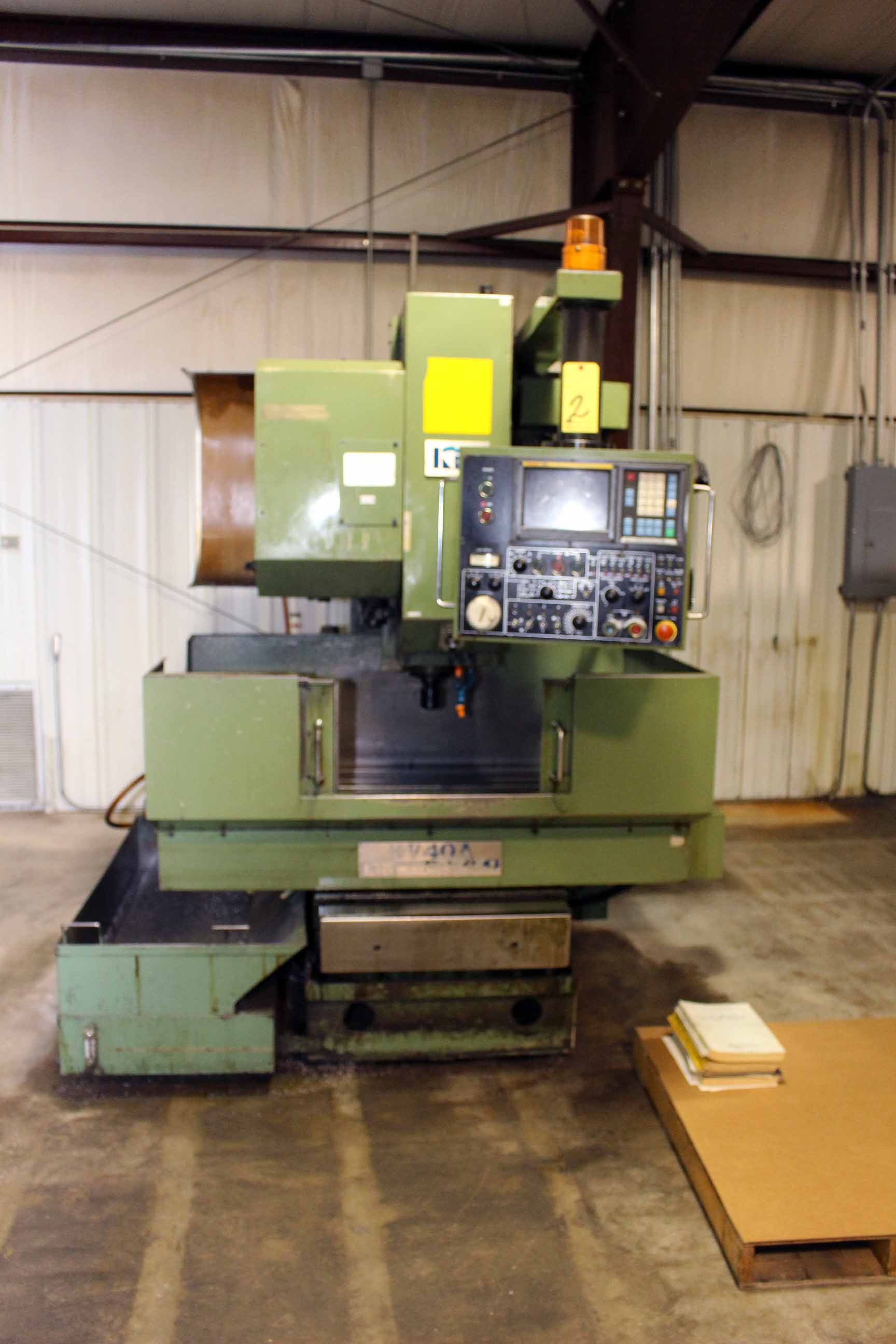 "Lot 2 - CNC VERTICAL MACHINING CENTER, KIA MDL. KV40A-0MB, new 11/1989, Fanuc OM-B CNC control, 24"" x 14"""