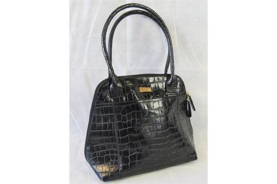 a black crocodile effect ladies handbag