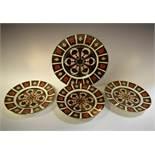 A set of three Royal Crown Derby 1128 pattern plates, 21.