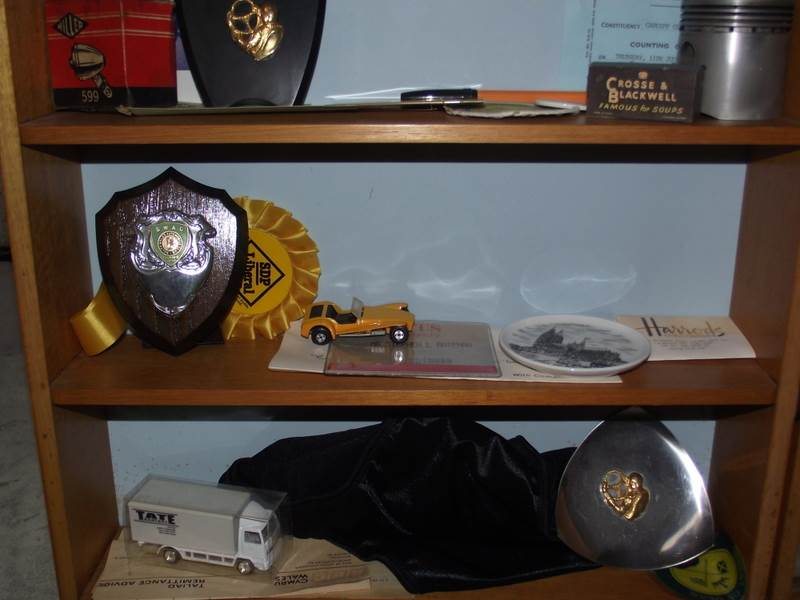 Lot 517 - An oak display cabinet of 1980's motor sport memorabilia including trophies, competition licences,