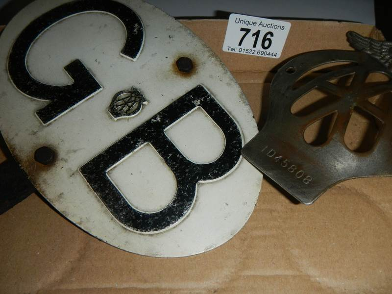 Lot 716 - An AA car badge and a GB plaque.