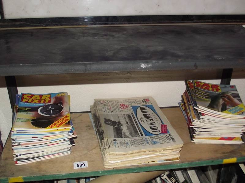 Lot 589 - A collection of car fixit magazines and old car/bike related newspapers.