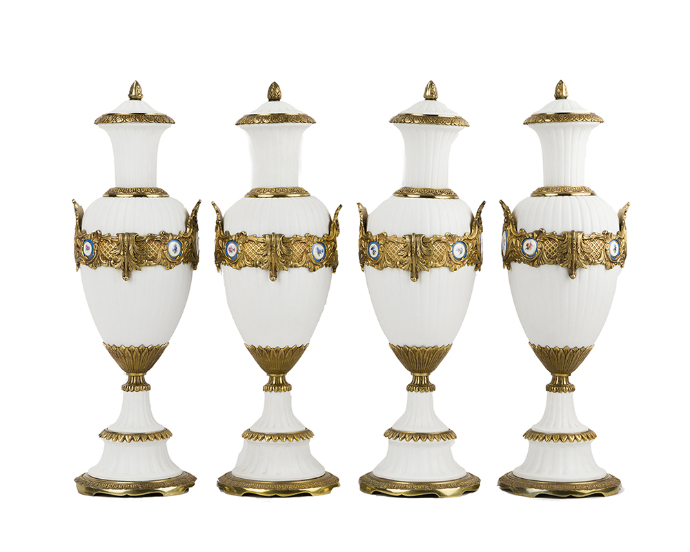 Lot 1053 - Four gilt-bronze and bisque urns