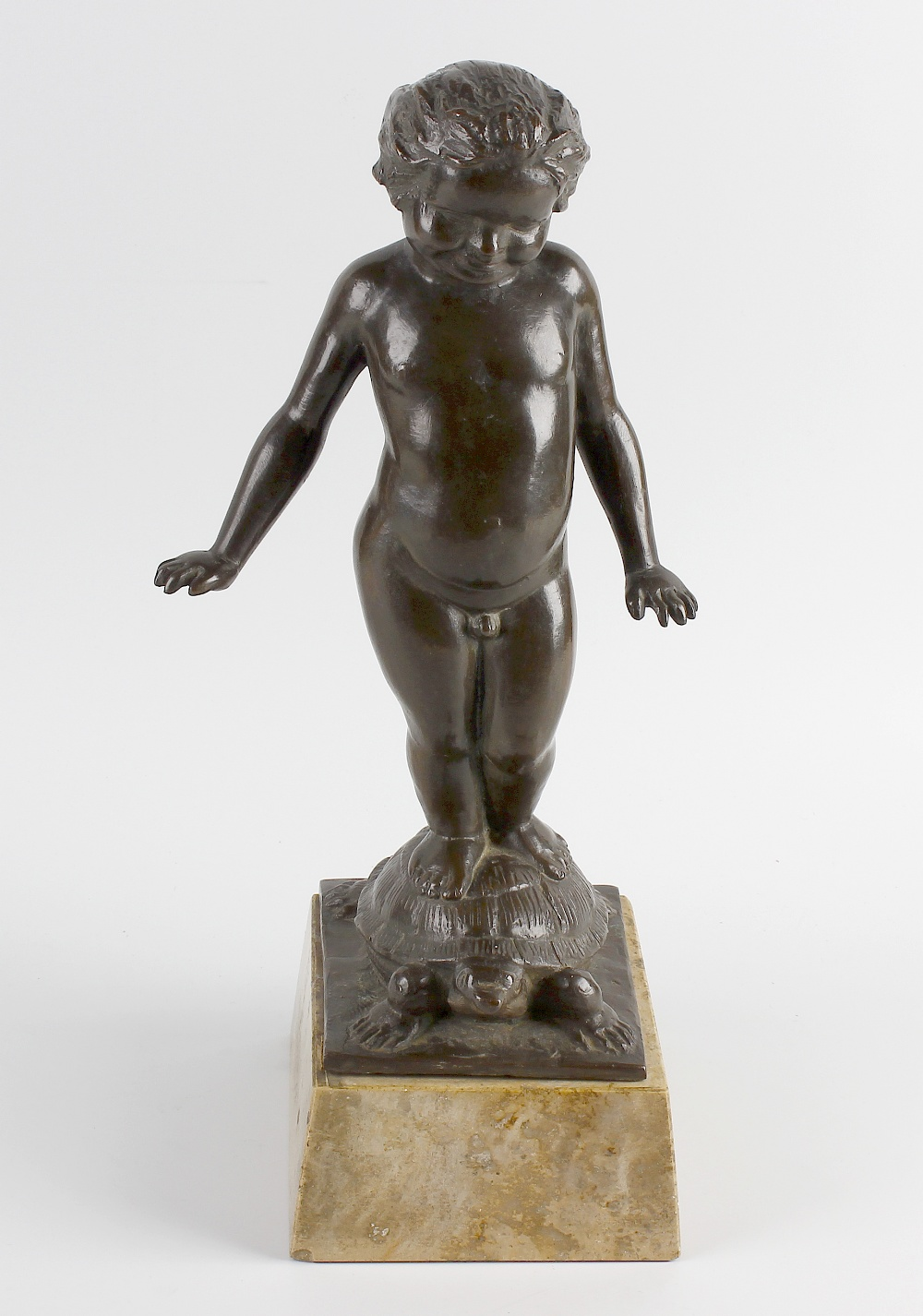 Lot 291 - Hans Parzinger. A cast bronze study of a naked young boy standing upon the back of a tortoise,