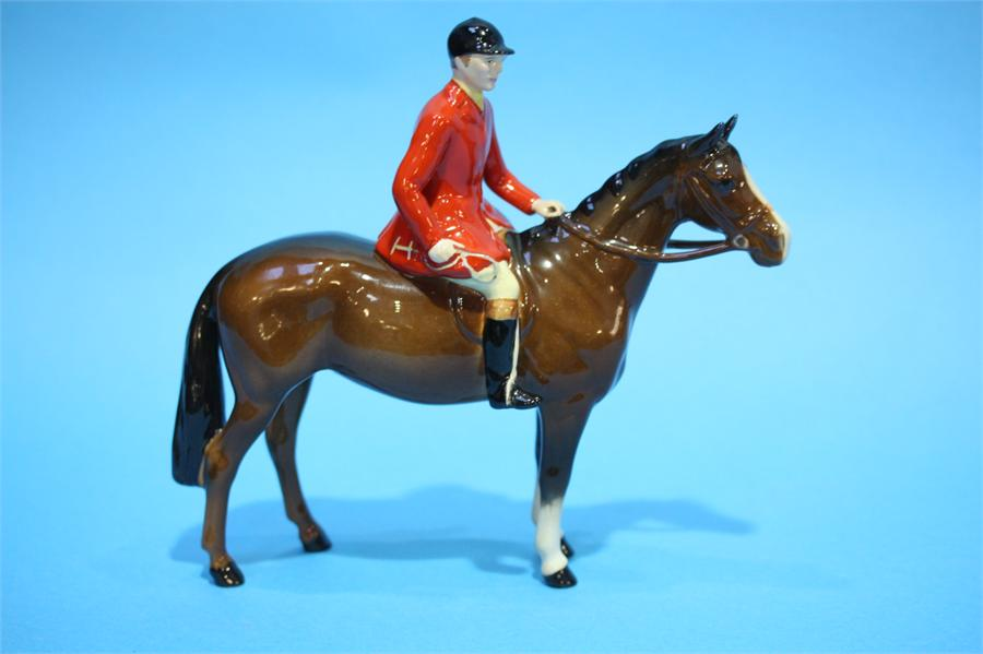 Lot 46 - Two Beswick Huntsmen with red tunics, seated upon