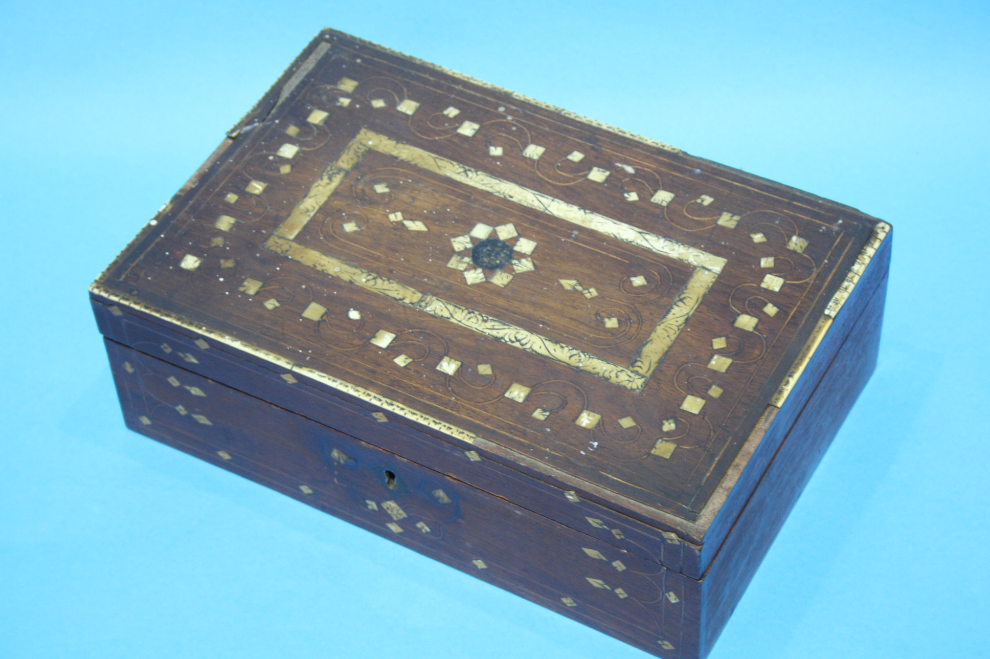 Lot 51 - An Oriental lacquered magazine rack and an ivory i
