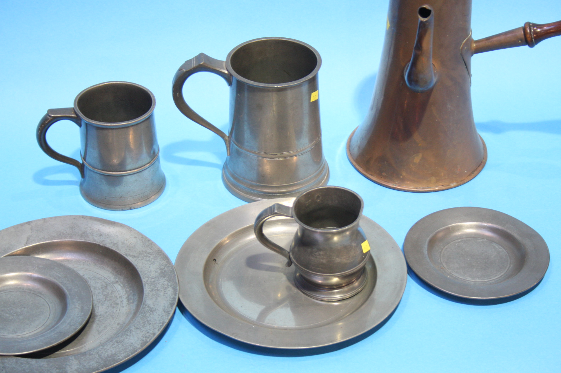 Lot 53 - A copper jug, three pewter tankards and pewter pla