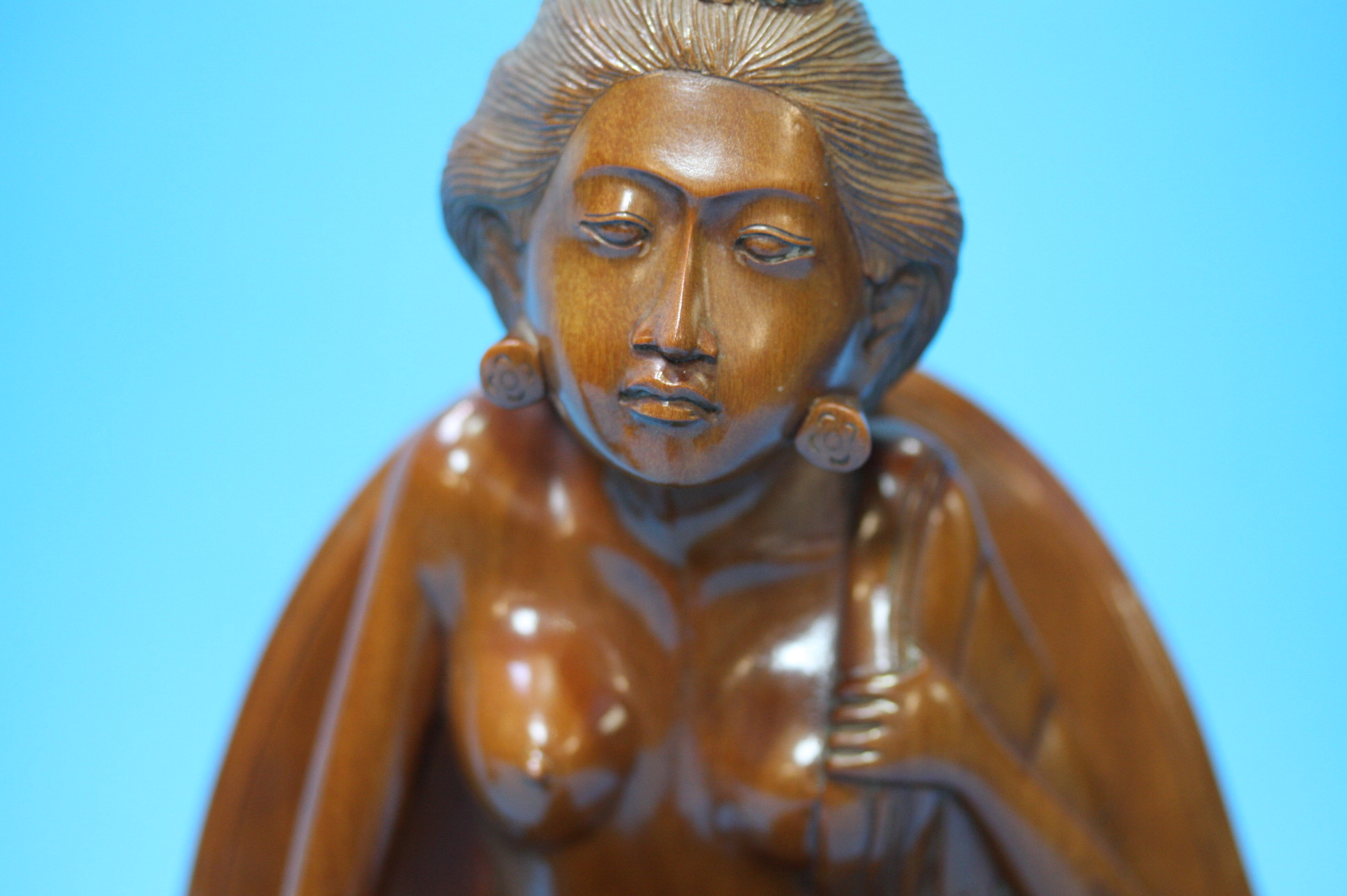 Lot 5 - Pair of carved Indonesian wooden figures.