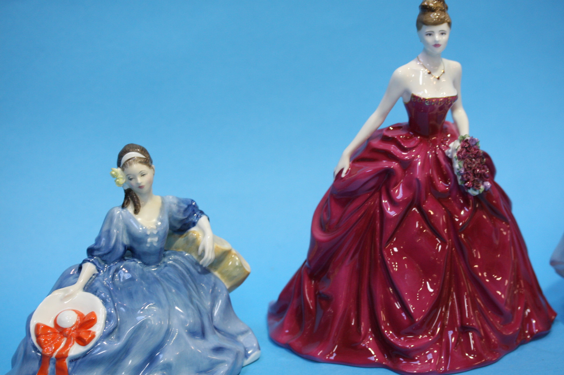 Lot 19 - Three Royal Doulton figures of ladies and a Coalpo
