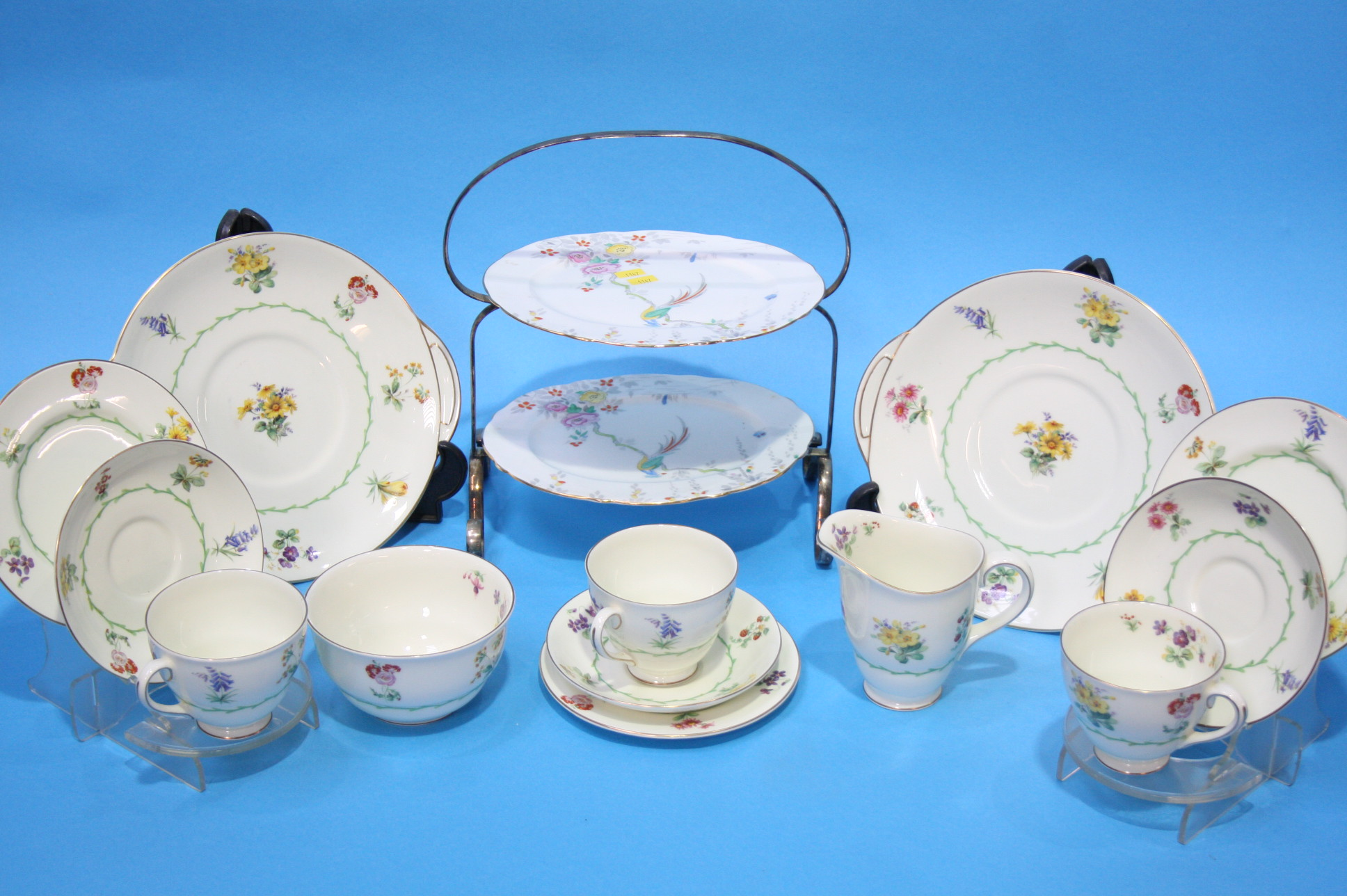 Lot 11 - A Royal Doulton floral tea set and a cake stand.
