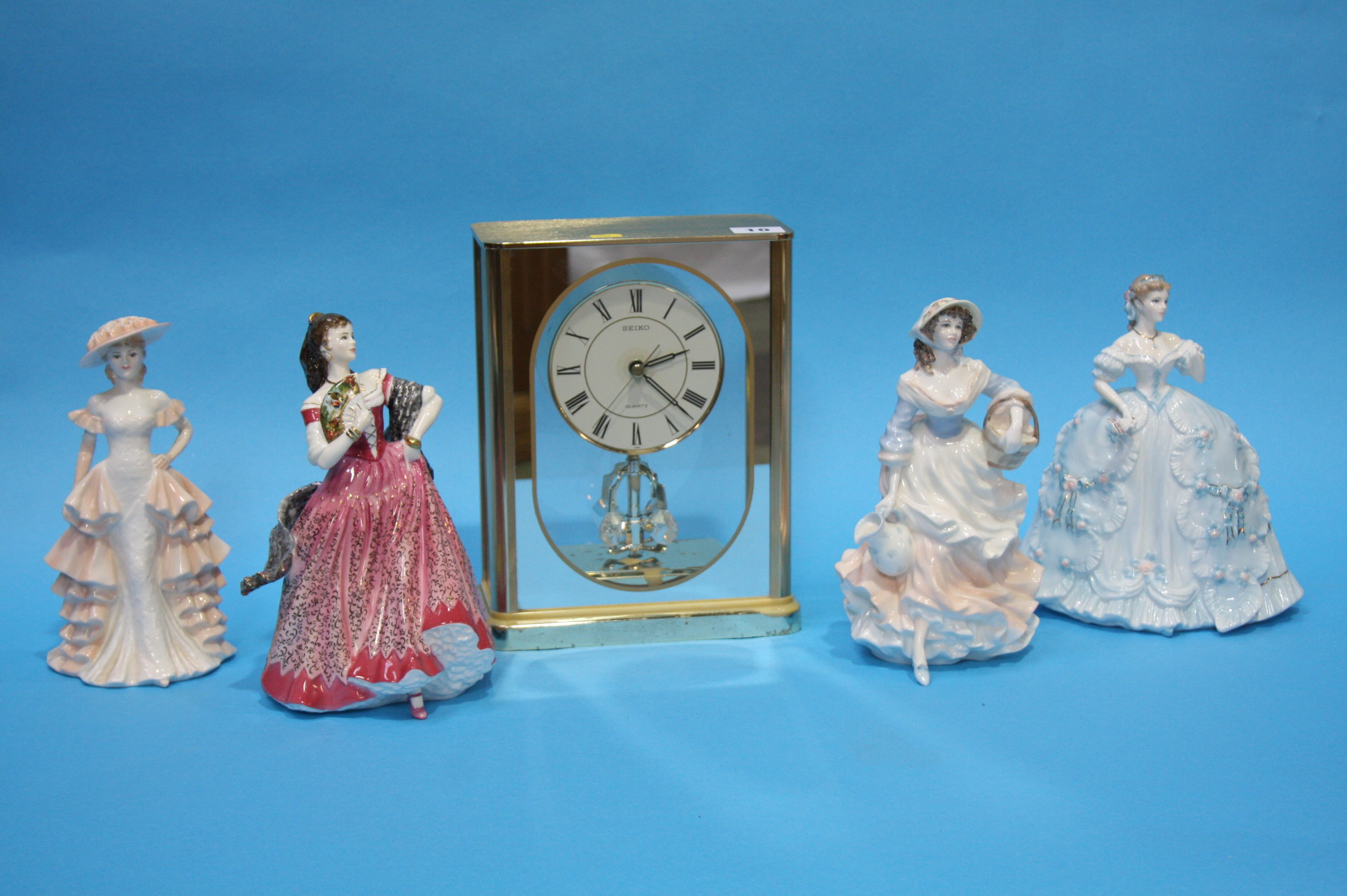 Lot 10 - Modern Seiko clock and four figurines.
