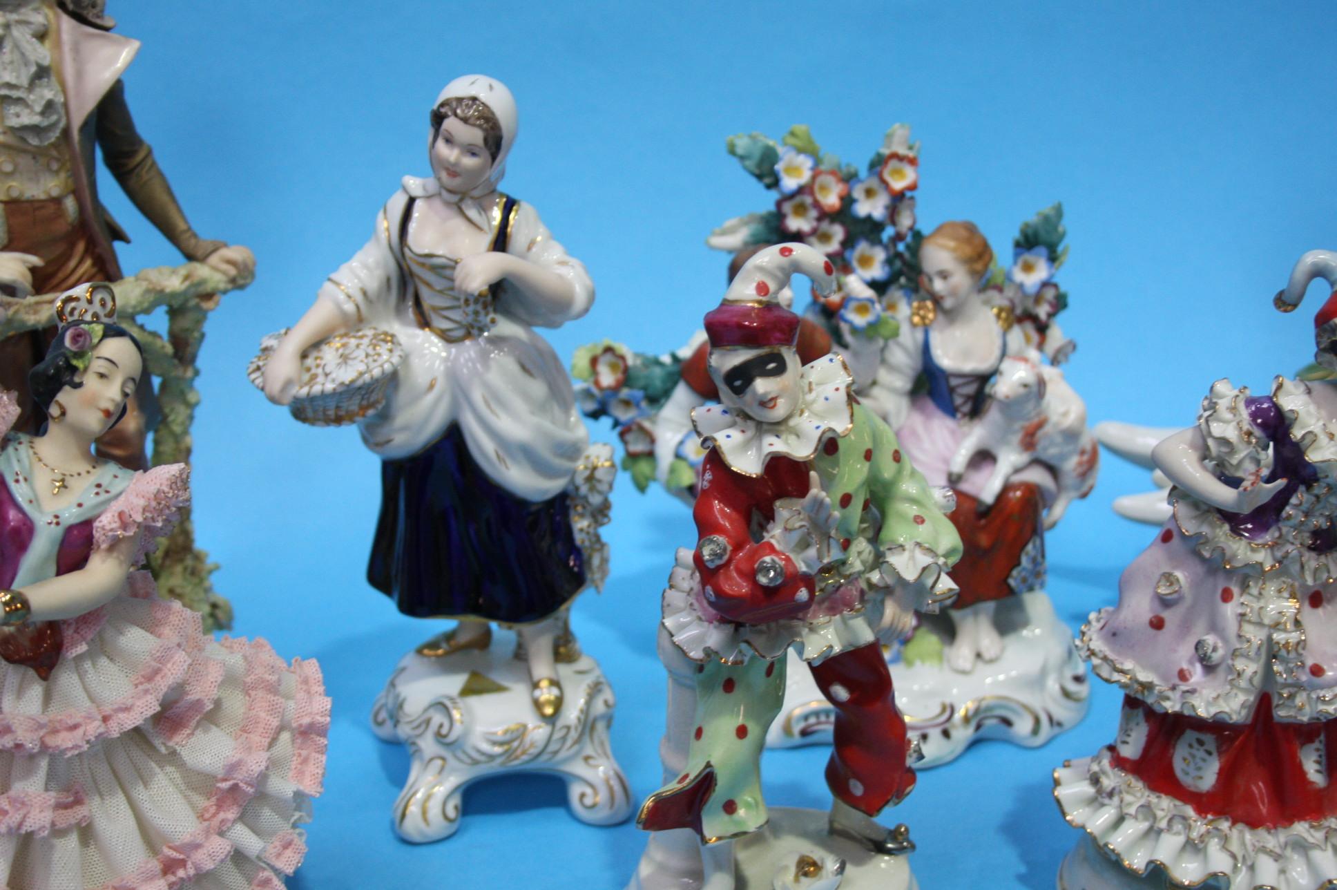 Lot 12 - Nine Continental figurines, various.