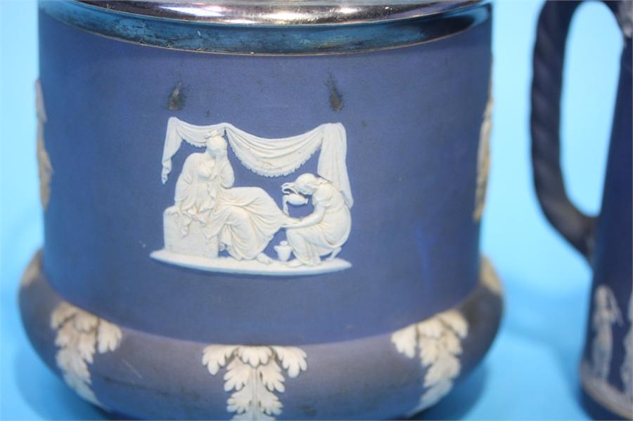 Lot 18 - A Wedgwood Jasperware biscuit barrel and water jug