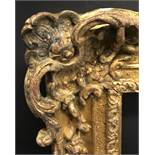 20th Century English School. A Gilt Composition Frame, with swept and pierced centres and corners,